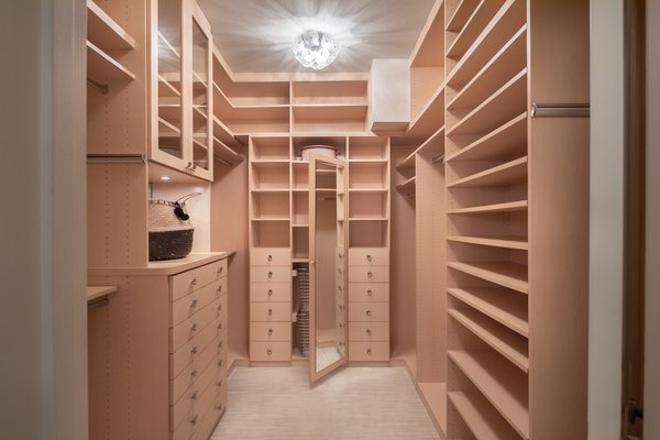 A spacious walk-in closet provides an abundance of storage in the master suite.
