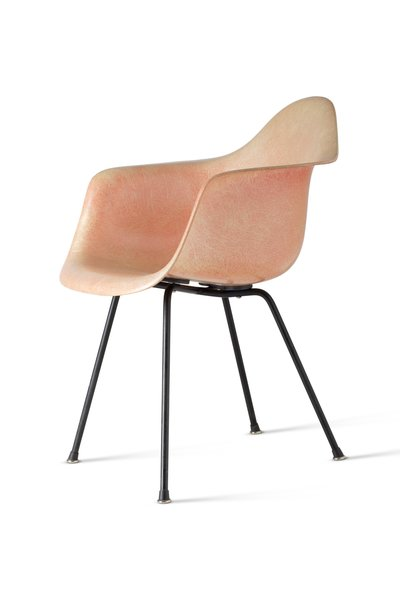 The Eameses adapted manufacturing techniques developed during World War II to mass-produce their Molded Plastic Armchair. The couple sought to express materials honestly and unselfconsciously—these were the first one-piece plastic chairs offered without upholstery or covering.