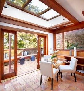 "Skylights rest above a cozy eating area, complete with French doors that lead to a side terrace. Often recognized as the creator of ""California design,"" Maybeck regularly integrated indoor/outdoor living into the homes he built, even as early as in the 1890s."