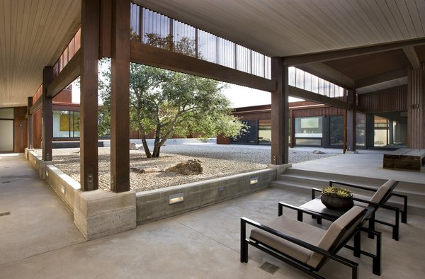 "A veranda connects the corner between two of the three pavilions. According to Fisher's website, the interior courtyard was designed to ""protect the residents from harsh wind and sun while providing an alternative view of landscape, which is contemplative, serene, and quiet."""