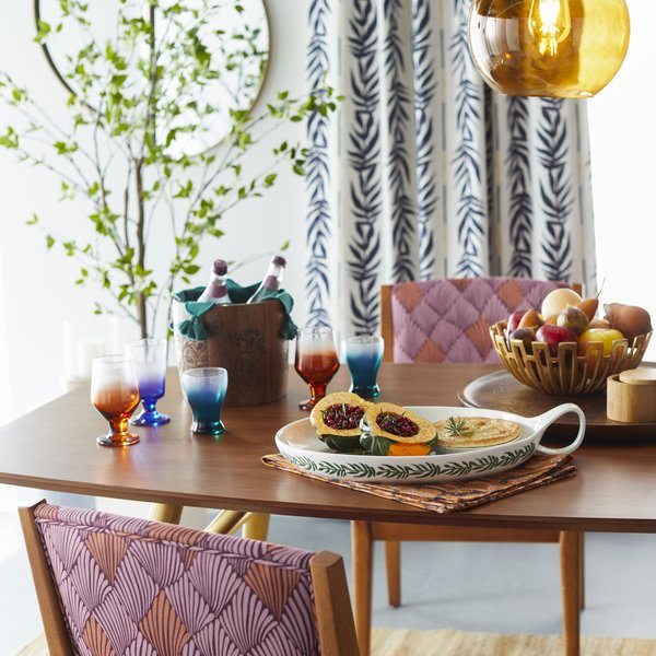 Ombre Glass Drinkware and a Vintage Palm Ceramic Serving Tray set the scene.