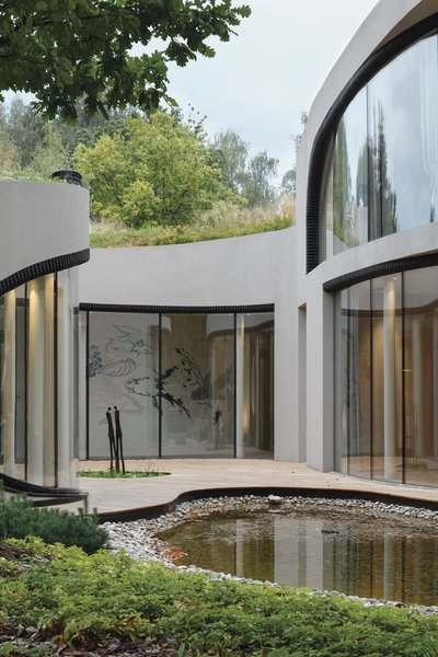 The home nestles a rear-facing courtyard that frames one of its many sculptures.