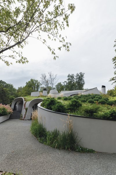 Planted pathways and staircases circumvent the property.