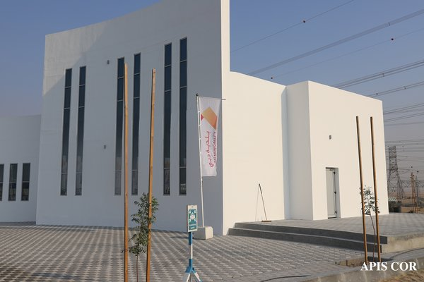 The lightly textured, finished facade is unassuming. The building will provide offices for a government agency.