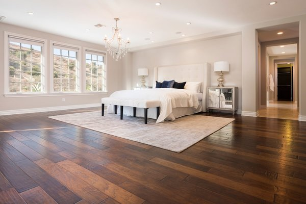 The bright and airy master suite features a large walk-in closet, as well as a private sun deck.