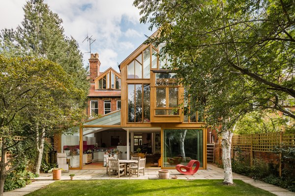 A full view of the wood and glass extension, which sits behind the original structure in the rear. Modern dormers were also added to the 1912 brick Edwardian.