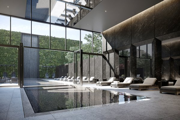 The rectilinear indoor/outdoor pool area is a break from the building's zagging exterior.