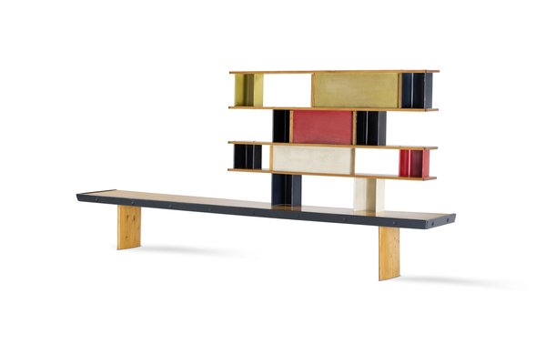 """Charlotte Perriand was a trailblazer in an era when even the progressive Bauhaus school barred women from furniture design courses. Shortly after garnering acclaim at the 1925 Expo des Arts Décoratifs at age 22, she joined the Paris design studio of Le Corbusier and Pierre Jeanneret where they collaborated on """"equipment for living."""" Post World War II, Perriand joined forces with Jean Prouvé to create modernist furniture like the Tunisie bookcase. The piece was made from oak, pine, mahogany, painted diamond-point aluminum, and painted metal, and it was manufactured by Prouvé's studio in 1952."""