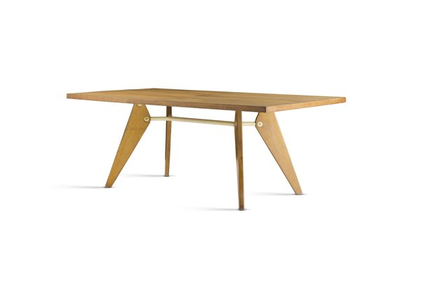 Designer and engineer Jean Prouvé developed the EM Table around 1950 for Maison Tropicale, an early prefabricated home. The table adheres to the aesthetics of necessity, and even its smallest details are determined by its construction. The canted legs are connected by a crossbar, illustrating the structural forces and flow of stresses in a way that is typically seen only in engineered structures.