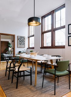 Another look at the large dining space. High ceilings and windows create a bright and airy atmosphere.