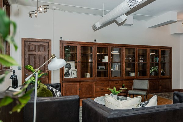 While thoughtfully updated for modern-day living, the loft retains a trove of original details, including built-in cabinetry that was part of the original classroom space. One can imagine the units filled with microscopes or specimens during the building's schoolhouse past.