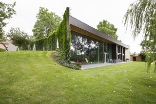 An Architect's Dramatic, Half-Buried Home in Belgium Wants $1.6M