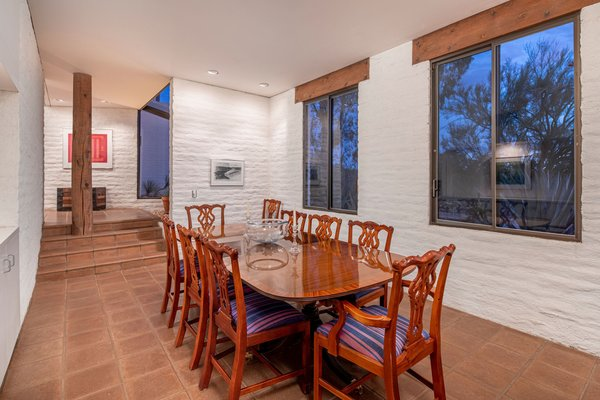 A few steps down is the formal dining room, which easily accommodates a table for eight. Original concrete tile floors run throughout the main living areas.
