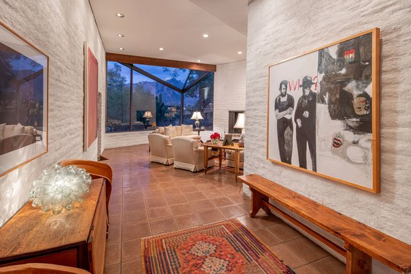 Also off the main entrance is the living room, which features an expansive bay window with views of the desert landscape and Mount Kimball in the distance.