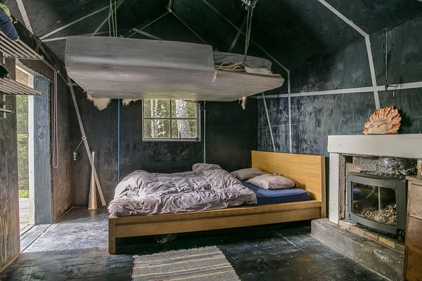 The original, one-room cabin is now the bedroom. A platform lowers from pulleys to provide additional sleeping space.