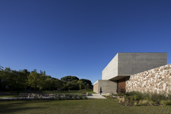 The home is primarily composed of three materials: concrete, stone, and wood.