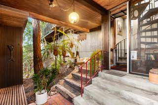 Down the spiral staircase, a covered outdoor area provides an intimate spot for entertaining.