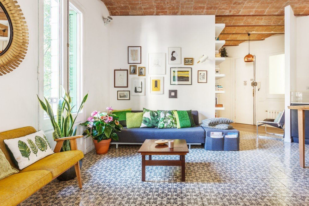 This three-bed, one-bath home is set in the Eixample Derecha, also known as the Golden Triangle of Barcelona. Inside, industrial chic and vintage artwork meet modern conveniences and comforts in this lovingly restored apartment.  Photo 16 of 16 in 16 Places to Stay in Barcelona for Less Than $100 a Night