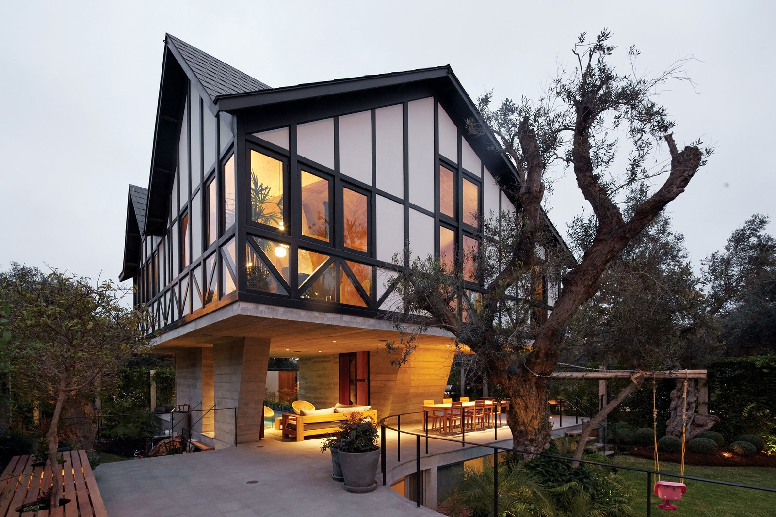 Faced with a number of challenges, including the protection of a cluster of centuries-old olive trees, 51-1 Arquitectos devised an unusual plan for a house in Lima, Peru. In a twist on Tudor Revival, one of only a few styles permitted in the neighborhood they raised the living area above a terrace.
