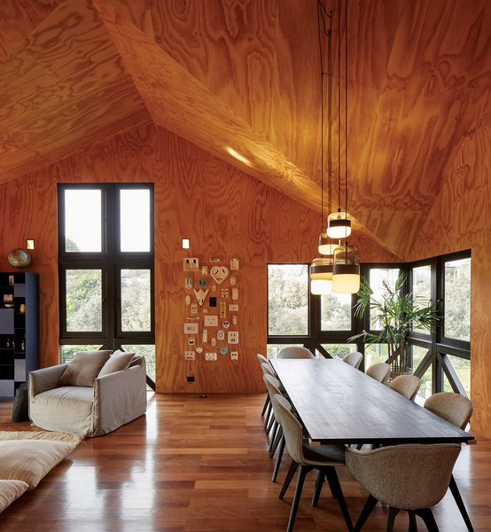 """Except for the board-formed concrete stairwell, the interior is clad entirely in pine plywood. """"It was a leap of faith to go with the plywood,"""" says Luciano, """"but now we look at it and just think, 'Wow.'"""""""