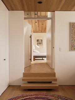 Opposite the desk, steps lead up to the master bedroom.