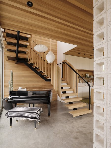 A switchback staircase accommodates a grand piano handed down from Anton's father.