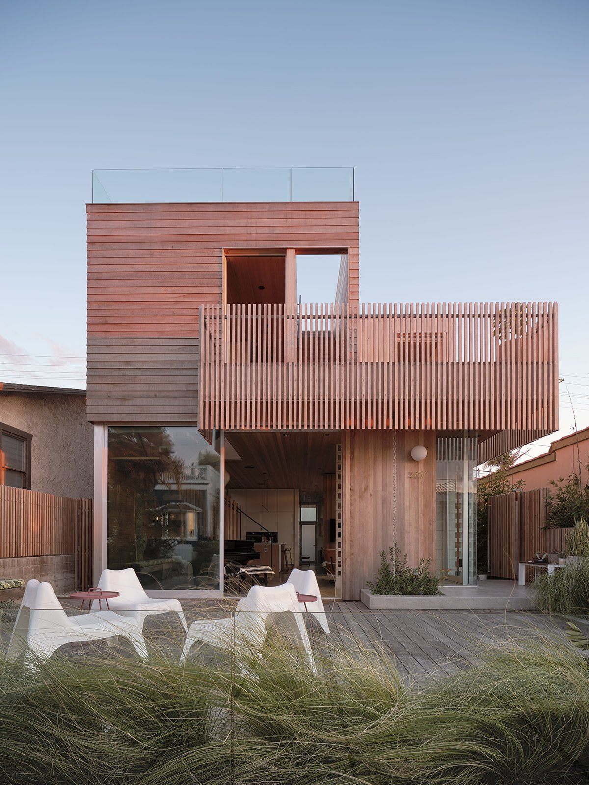 Exterior, House, Beach House, Wood, and Flat Making maximum use of a tight footprint, architect Robert Sweet designed a two-story home in Hermosa Beach that provides plenty of flexible indoor/outdoor space for residents Anton and Mardi Watts and their children.  Exterior Flat Wood Beach House Photos from It Took a Neighborhood to Build This Beachside Bungalow