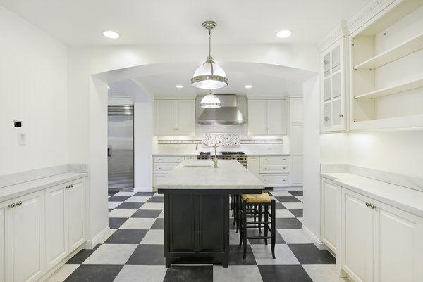 Featuring top-of-the-line appliances, the newly remodeled kitchen also offers plenty of storage.