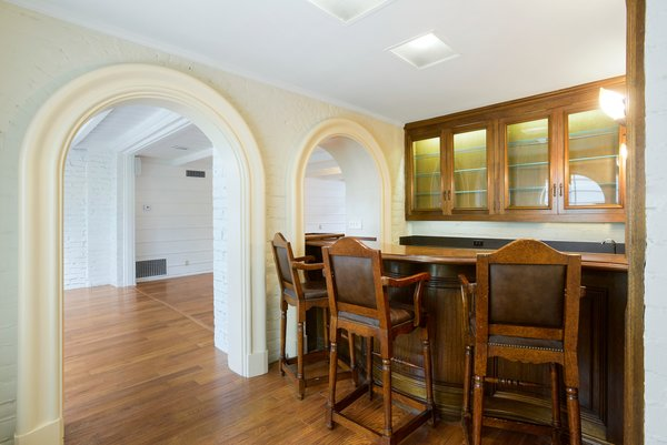 Arched doorways lead into the home's wet bar.