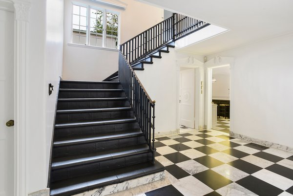 Thoughtfully updated for modern-day living, the residence also features many original details, such as a dramatic black-and-white checkered floor in the foyer.