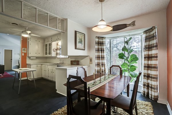 A closer look at the dining room, which features a bay window overlooking the backyard.