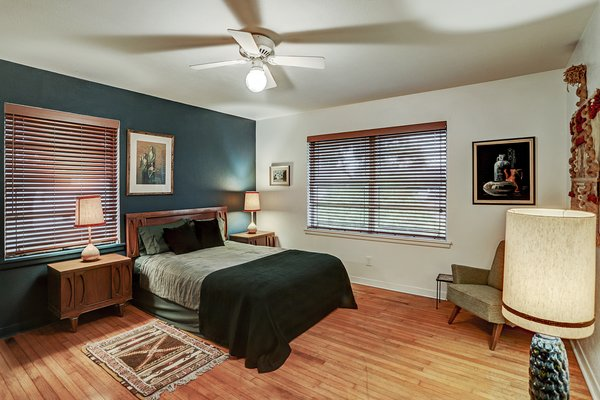 A peek inside one of the home's three bedrooms, all which feature hardwood floors.