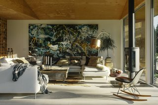 Cori's 12-foot-long Paradise painting adds a dramatic touch to the living room.