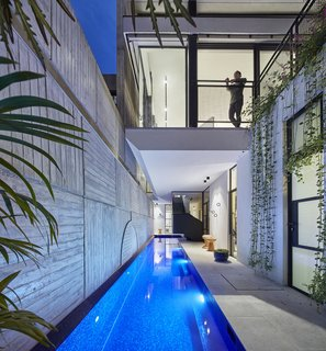 The lap pool glistens with vivid blue tiles.