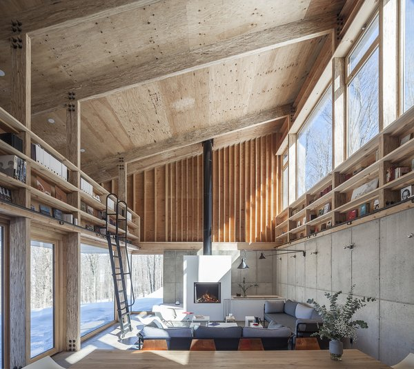 Maria Milans del Bosch's Catskills home is attuned to the changing seasons. Sunlight pours into the double-height living room, where a Stûv fireplace and radiant floors keep the space warm in winter.