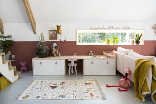 Cato's play-space features IKEA cabinets and a rug by Lakaluk.