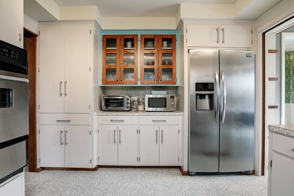 Another view of the kitchen. Floor-to-ceiling cabinets provide an abundance of storage.