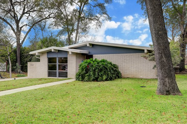 Nestled on a lush lot with mature trees sits 5443 Whispering Creek Way, a charming one-level midcentury that was recently treated to a top-down renovation.
