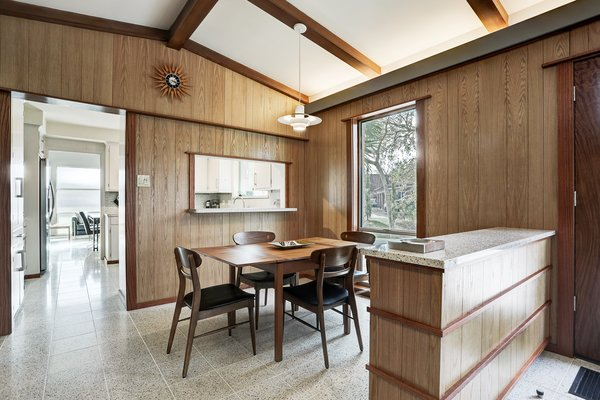 A more casual breakfast nook sits just steps away from the kitchen.