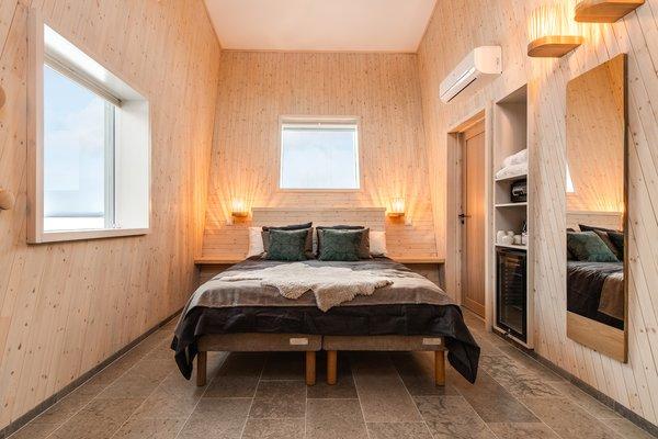 Inside the suites, sleek wood and tile make for svelte interiors.