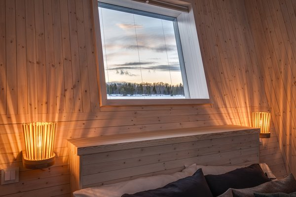 The windows of the floating suites provide views of the flowing—or frozen—Lule River.