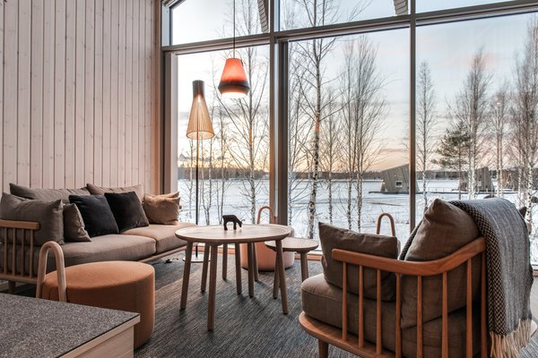 Some cabins can hold five guests, while others are designed for two. Scandinavian furnishings complete each unit.