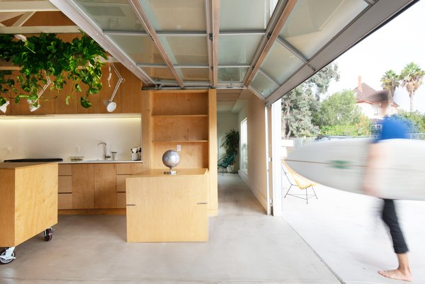 Anchoring a multi-family property in Chula Vista is a 1,200-square-foot garage that Ramiro Losada-Amor of Modern Granny Flat transformed into an ADU for Jorge Cuevas Antillón and Ruben Martínez. The garage door is from Coastal Garage Doors.