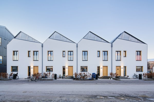 The compact row houses feature carefully angled solar panels that harness every moment of the sun.