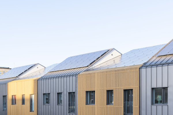 The solar panel–topped roofs vary slightly in height for added visual interest.