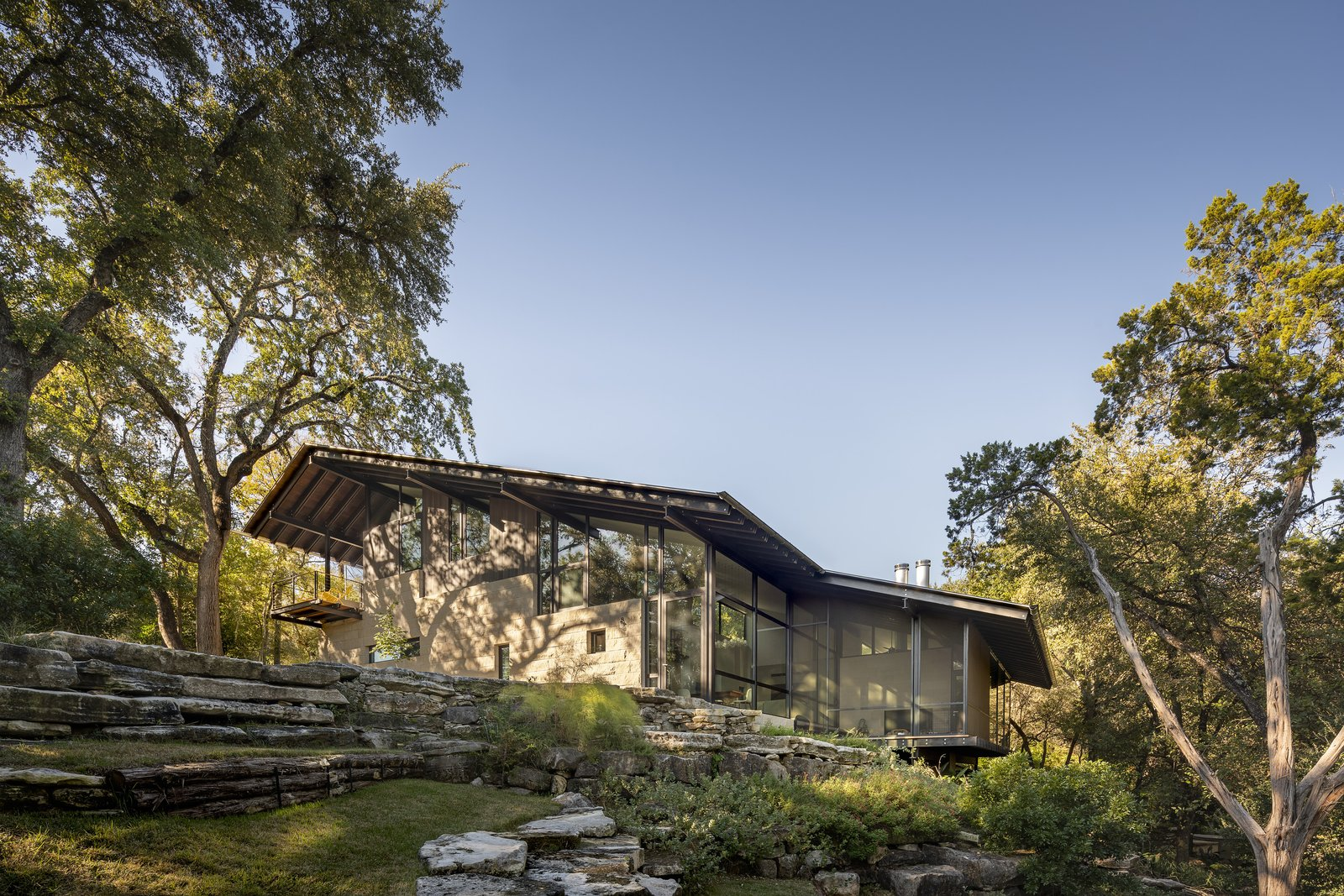 This Spectacular Texas Retreat Cascades Down a Wooded Hillside