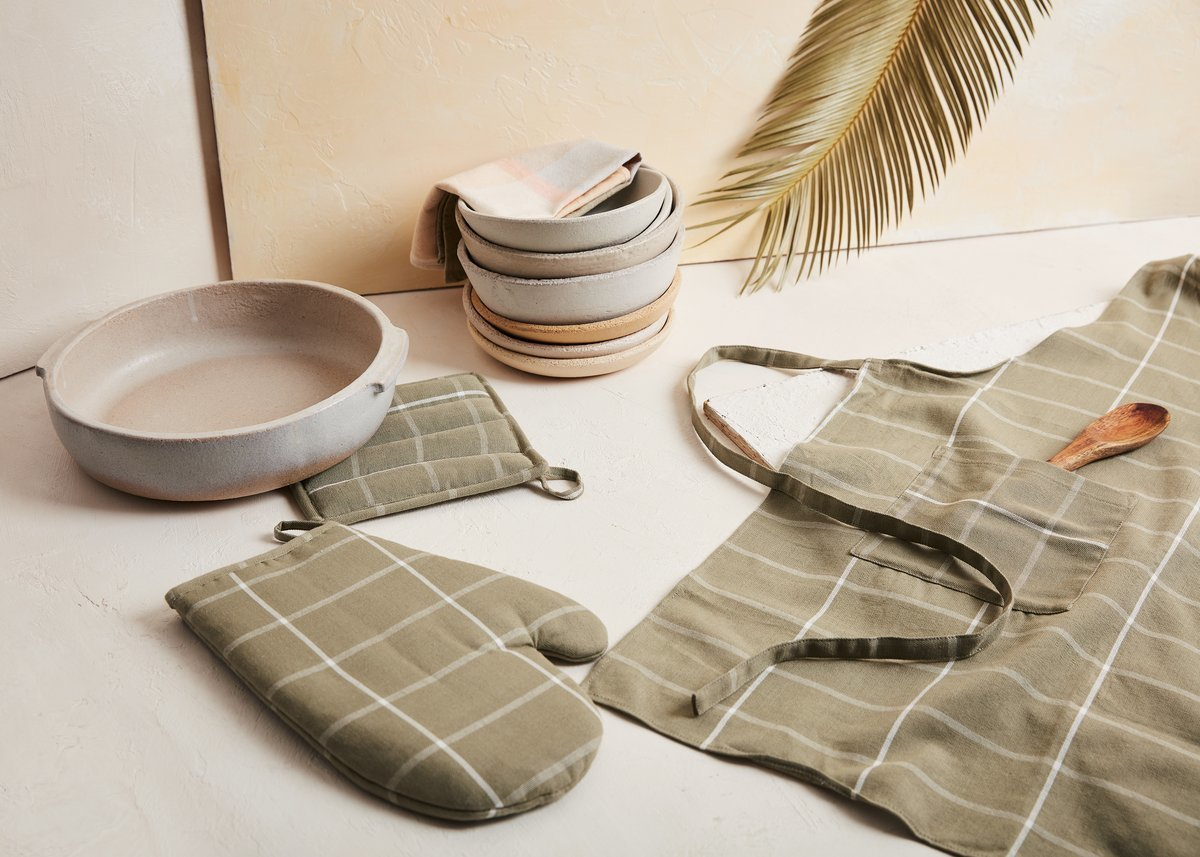 The spring/summer collection features a new color for MINNA's grid oven mitt, potholder, and apron: sage.  Photo 2 of 2 in MINNA Just Dropped a Delightful New Collection of Home Goods Just in Time for Spring
