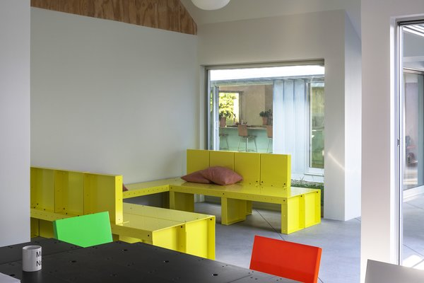 """""""In architecture, we tend toward natural materials and raw metals. In furniture, we like color,"""