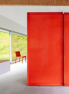 The home near Saratoga Springs, New York, features custom-designed furnishings, as well as brightly colored sheet-metal partitions and finishes.