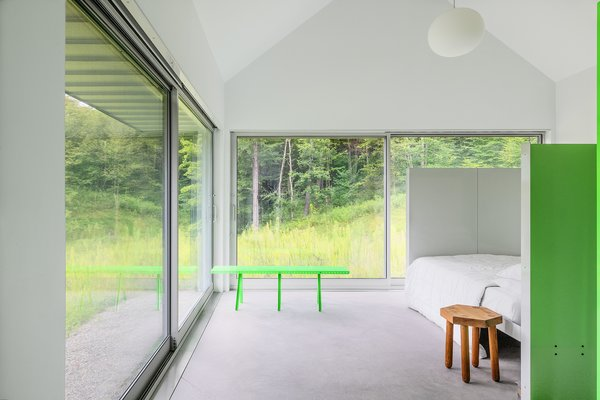 """From the bedrooms to the common areas, each room flows into the next without a traditional hierarchy. <span style=""""font-family: Theinhardt, -apple-system, BlinkMacSystemFont, &quot;Segoe UI&quot;, Roboto, Oxygen-Sans, Ubuntu, Cantarell, &quot;Helvetica Neue&quot;, sans-serif;"""">The bedroom furniture is by MOS, and the bedding is by Pendleton.</span>"""